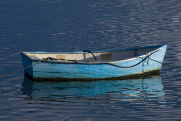 Blue small boat tied