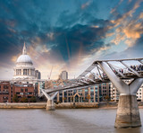 London, UK. Wonderful side view of Millennium Bridge at sunset,