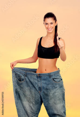 Slim woman with huge pants
