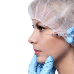Botox injection in beautiful female face isolated