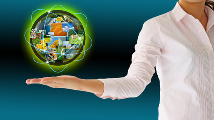 Businesswoman holding world .Technology concept