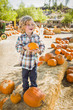 Little Boy Holding His Pumpkin at a Pumpkin Patch.