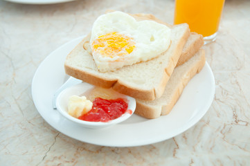 Breakfast - toasts, egg and strawberry jam