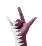 Hand making I love you sign, Qatar flag painted