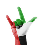 Hand making I love you sign, UAE flag painted