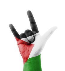Hand making I love you sign, Palestine flag painted