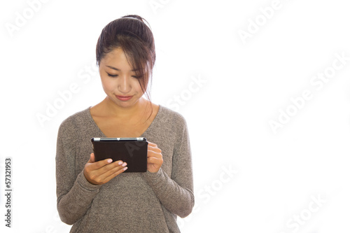 Asian young woman using iPad tablet pc ebook