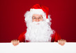 Portrait of a santa holding blank placard