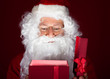 Close-up of santa looking in gift