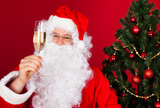 Portrait of a happy santa holding wine glass