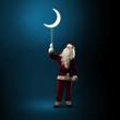 Santa Claus holding a shining moon