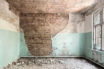 Desolate room with broken window