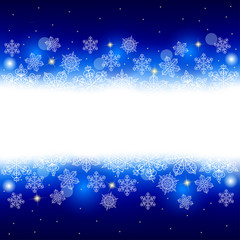 Winter background with snowflakes and glowing place for text