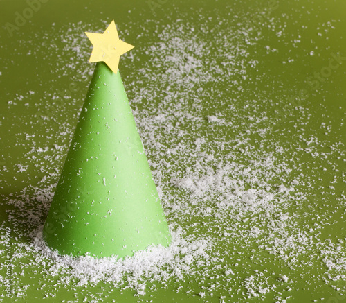 Christmas abstract paper tree on green background