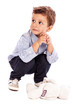 Portrait of an adorable little boy looking away