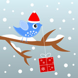 Christmas scene with blue bird and gift.