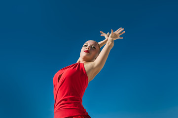 Flamenco dancer over blue sky