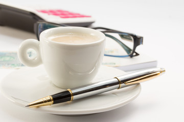 Workong environment with coffee glasses pen calculator and money