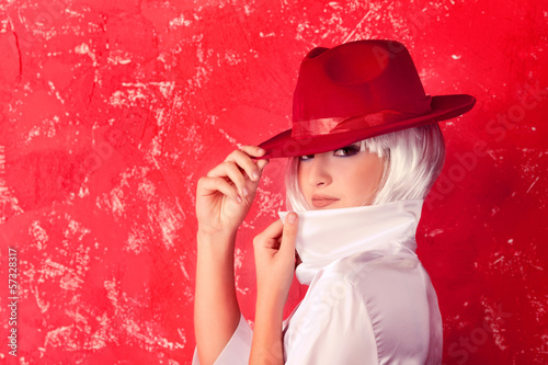 Cute blonde wearing red hat and posing