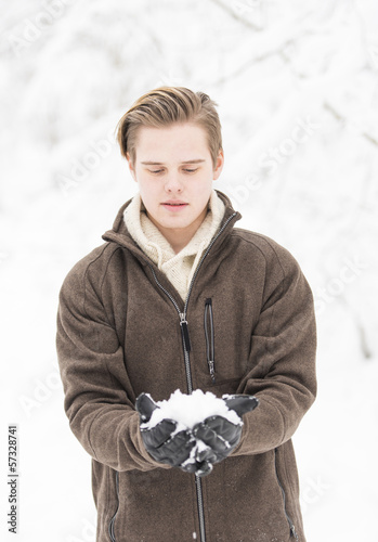 Attractive young adult man in winter clothes