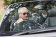 Mature businessman adjusting his cabriolet rear view mirror
