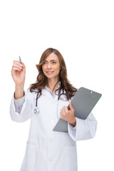 Doctor holding clipboard and pointing at something