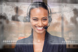 Attractive smiling businesswoman using futuristic interface