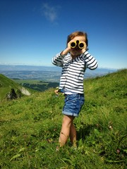 child with binoculars