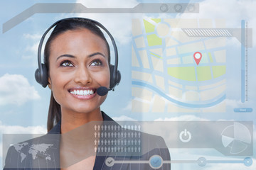 Smiling attractive businesswoman looking at futuristic interface