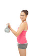 Pretty sporty brunette holding grey and pink kettlebell