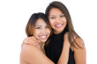 Two dressed up asian sisters embracing