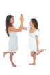 Two smiling young women high fiving