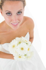 High angle view of cute bride holding a bouquet
