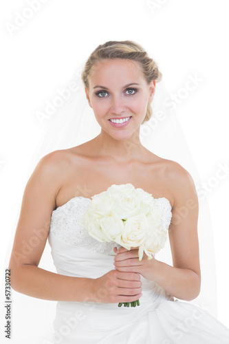Attractive young bride posing holding a bouquet