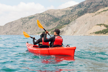 Young couple in a sea kayak.