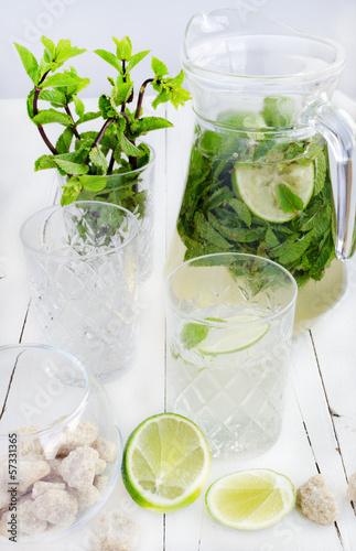 Mojito in the glass and jar, lime and cane sugar