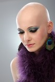 Portrait of hairless woman in purple boa