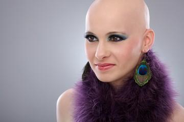 Portrait of bald woman in purple boa