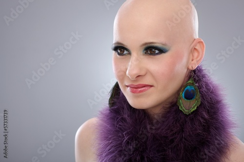Portrait of bald woman in purple boa