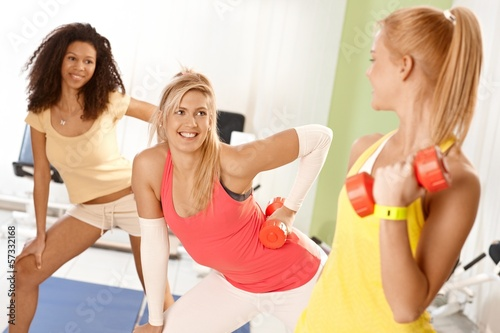 Pretty girls exercising with dumbbells