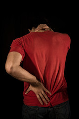 Young man with neck and back pain