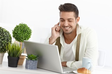 Young businessman having breakfast at home
