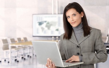 Businesswoman with laptop in meeting room