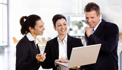 Happy business people with laptop