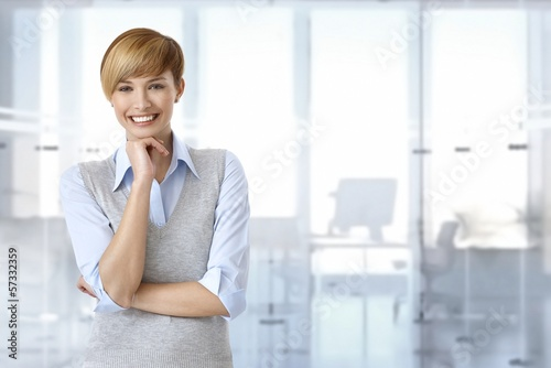 Happy businesswoman at office