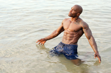 Black bodybuilder relaxing in the water after a hard workout