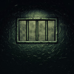 Prison cell door,barred window ,dramatic lighting