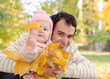 Dad and daughter with leaves