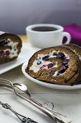 Blueberry and strawberry chocolate roll with tea