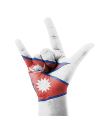 Hand making I love you sign, Nepal flag painted